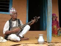 Mohan Gandharba, traditional musician and shaman at his house with his wife