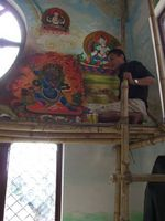 Newari artist painting walls in Buddhist temple, Kathmandu Valley, Nepal