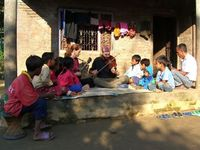 performing small concert for village kids in the Terai region, Nepal